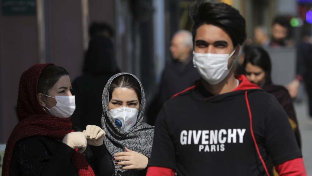 Pedestrians wear masks to help guard against the Coronavirus, in downtown Tehran, Iran, Sunday, February 23, 2020.  (AP Photo/Ebrahim Noroozi)