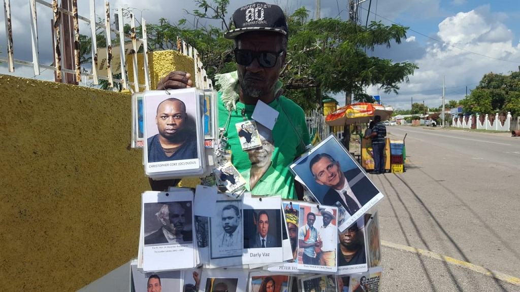 Phillip Sawyers displays prominent current and former prominent figures of the JLP, among other notable Jamaicans, via his human billboard. (Photo: Marlon Reid)