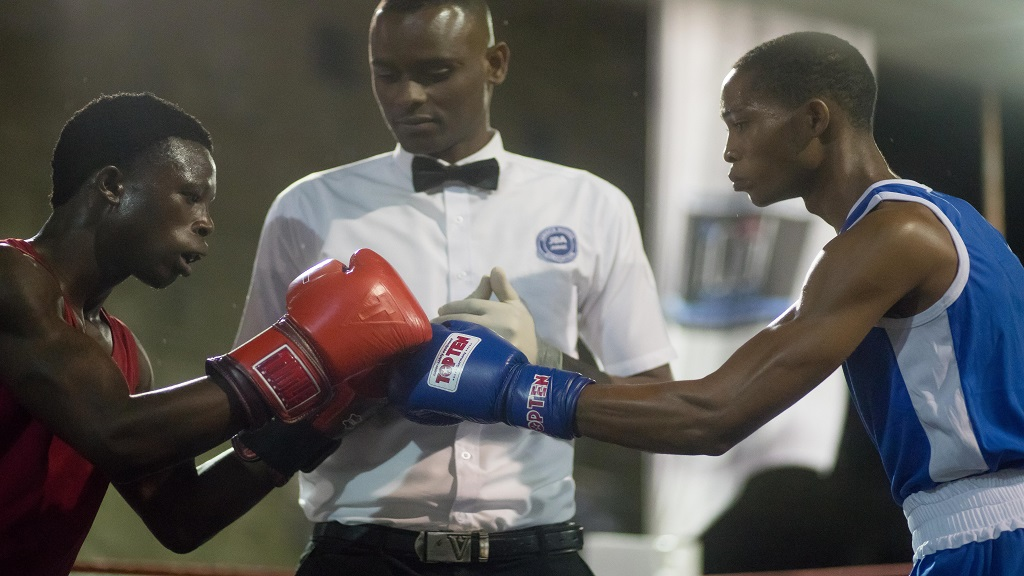 """Sanji Williams (left) of Jamaica and Joe Mejia of Panama touch gloves during the Jamaica Boxing Board's Jamaica vs Panama """"Gloves Over Guns' fight card at the new boxing gym in Montego Bay on Saturday, February 29, 2020. Williams scored a first-round knockout victory over Mejia."""
