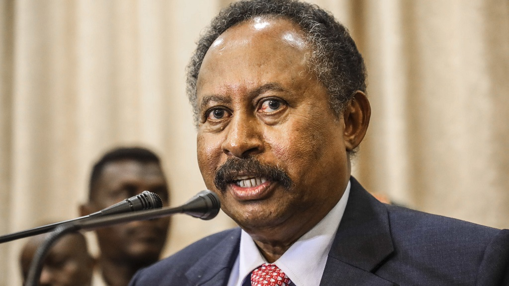 FILE - In this Aug. 21, 2019, file photo, Sudan's new Prime Minister Abdalla Hamdok speaks during a press conference in Khartoum, Sudan. Sudan's state media Monday, March 9, 2020, says Hamdok has survived an assassination attempt after a blast in the capital Khartoum. (AP Photo, File)
