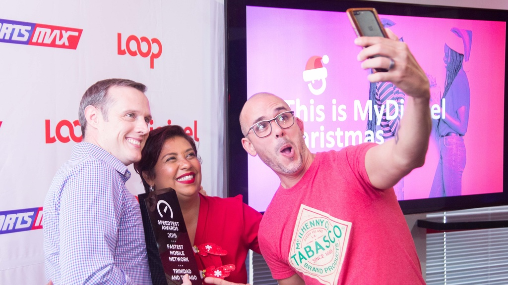 A place for selfies: Abraham Smith, Digicel's Commercial Director and Rachel and Christian Jardine of 'Check Ting'