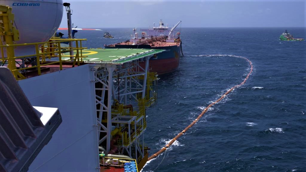The fuel hose leads from the Liza Destiny to the Cap Philippe for the transfer of Guyana's first million barrels of crude. Photo: Ministry of the Presidency of Guyana.
