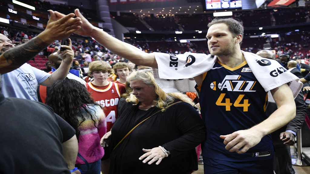 Utah Jazz forward Bojan Bogdanovic (44) high-fives a fan after shooting the game-winning three point basket during the second half of an NBA basketball game against the Houston Rockets, Sunday, Feb. 9, 2020, in Houston. (AP Photo/Eric Christian Smith).