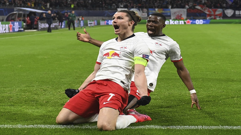 Leipzig's Marcel Sabitzer, centre, celebrates after scoring a goal during the Champions League round of 16, 2nd leg football match against Tottenham in Leipzig, Germany, Tuesday, March 10, 2020. (Hendrik Schmidt/dpa via AP).