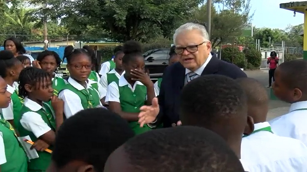 Acting Education Minister Karl Samuda speaks with students of  Tulloch Primary in St Catherine ahead of their sitting of PEP on Tuesday.