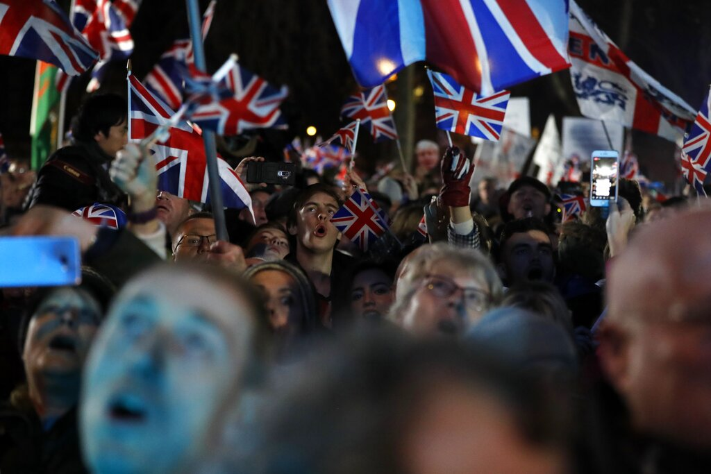 Brexit supporters celebrate during a rally in London, Friday, Jan 31, 2020. Britain leaves the European Union after 47 years, leaping into an unknown future in historic blow to the bloc. (AP Photo/Frank Augstein)