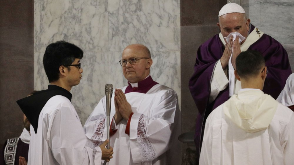 In this Wednesday, Feb. 26, 2020 file photo Pope Francis wipes his nose during the Ash Wednesday Mass opening Lent, the forty-day period of abstinence and deprivation for Christians before Holy Week and Easter, inside the Basilica of Santa Sabina in Rome (AP Photo/Gregorio Borgia).