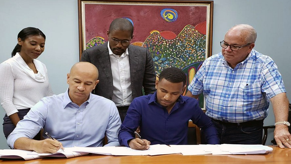 SSL finalizing the sale of its majority stake in Dolla Financial Services. The Investment house has divested the micro finance operation as it refocuses on its private equity operations. Seated (left), Zachary Harding -SSL Group CEO, Seated (right), Kadeen Mair- CEO, Dolla Financial Services. Standing (left to right) Allison Hemmings- CFO SSL, Marc Ramsay- Partner Ramsay Smith, Hugh Croskery-Founder, SSL.