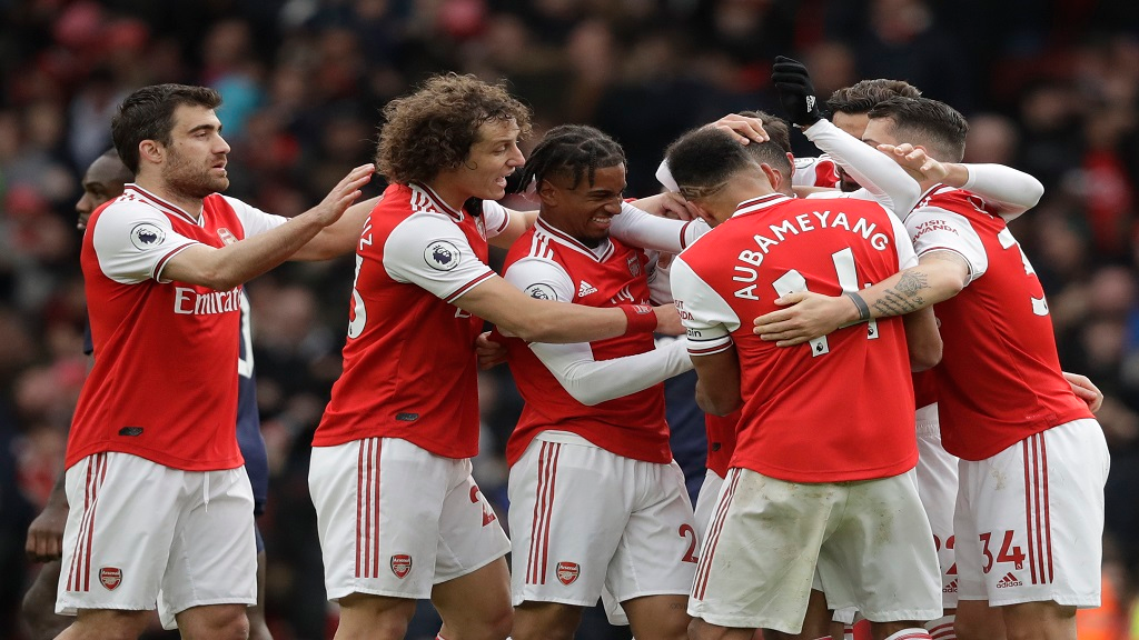 Arsenal's players celebrate a goal during the Premier League football match against West Ham at the Emirates Stadium in London, Saturday, March 7, 2020.(AP Photo/Matt Dunham)