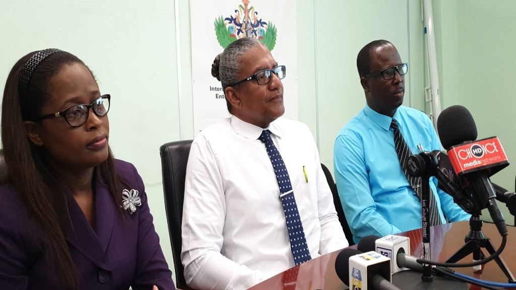 Sophia Henry, PS Ministry of Commerce; Minister of Commerce Bradley Felix; Dr Thomas Samuel, Director of International Trade