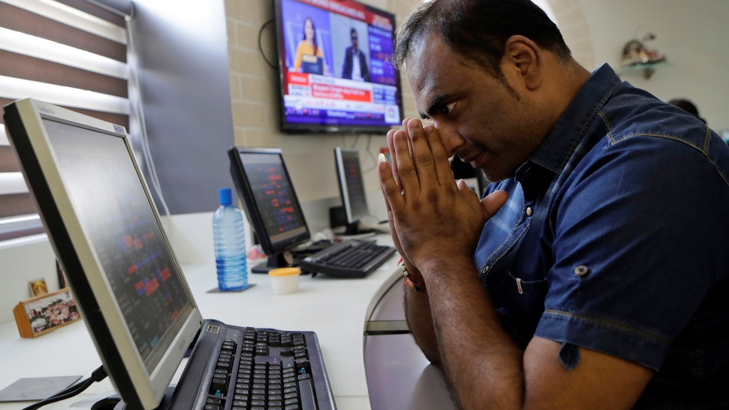 An Indian stockbroker gestures as he watches the Bombay Stock Exchange (BSE) index on a trading terminal in Mumbai, India, Monday, March 9, 2020. Global stock markets and oil prices plunged Monday after a squabble among crude producers jolted investors who already were on edge about the surging costs of a virus outbreak. India's Sensex retreated 6.2% to 35,255.73. (AP Photo/Rajanish Kakade)