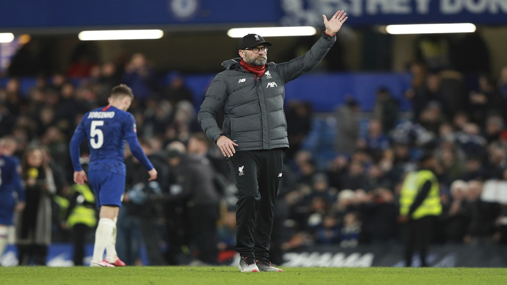 Liverpool's manager Jurgen Klopp applauds fans at the end of the English FA Cup fifth round football match against Chelsea at Stamford Bridge stadium in London Tuesday, March 3, 2020. (AP Photo/Ian Walton.