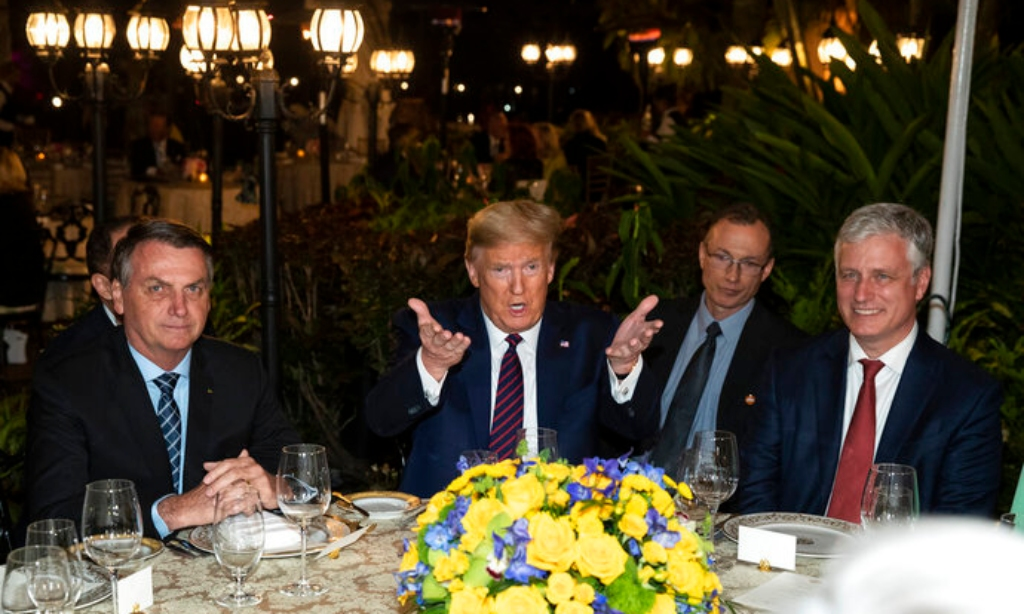 President Donald Trump speaks before a dinner with National Security Adviser Robert O'Brien, right, and Brazilian President Jair Bolsonaro, left, at Mar-a-Lago, Saturday, March 7, 2020, in Palm Beach, Fla. (AP Photo/Alex Brandon)