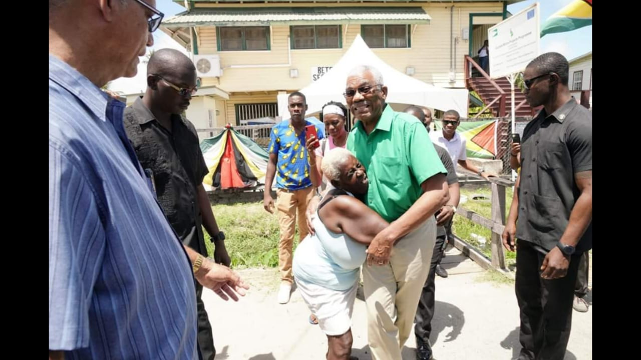 APNU Leader, David Granger embraced by a supporter.