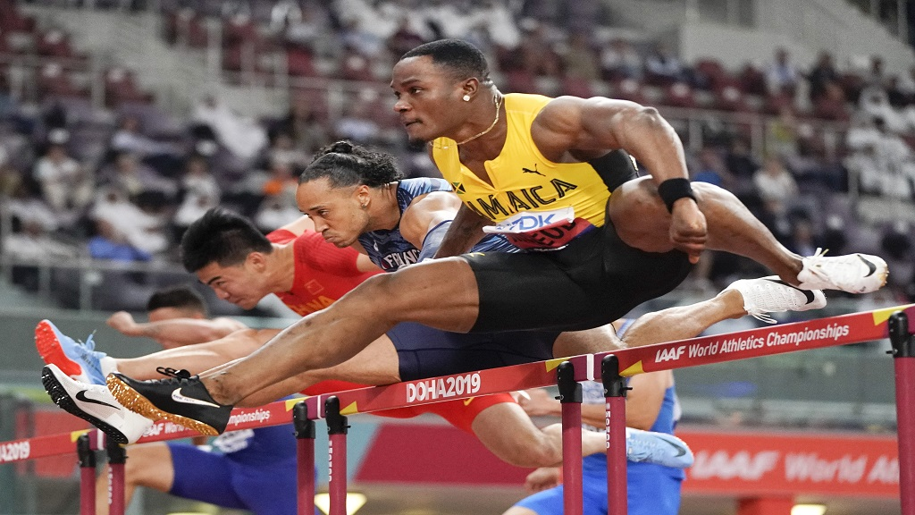 Omar Mcleod, of Jamaica, competes in the men's 110m hurdles semifinal at the World Athletics Championships in Doha, Qatar, Wednesday, Oct. 2, 2019. (AP Photo/David J. Phillip).
