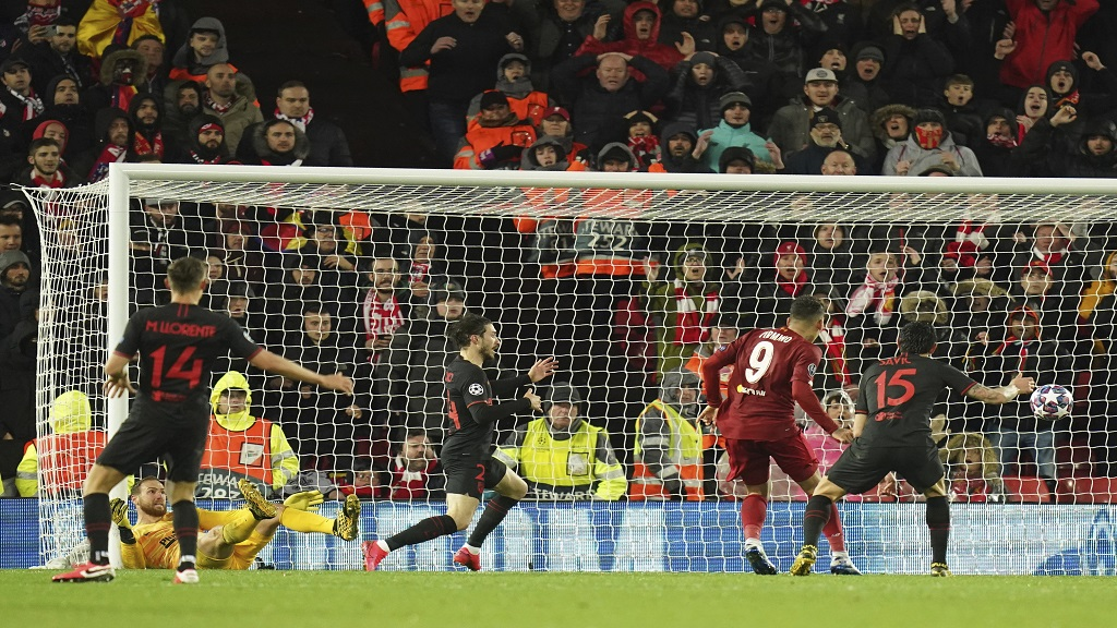 Liverpool's Roberto Firmino, second right, scores his side's second goal during a second leg, round of 16, Champions League football match against Atletico Madrid at Anfield stadium in Liverpool, England, Wednesday, March 11, 2020. (AP Photo/Jon Super).