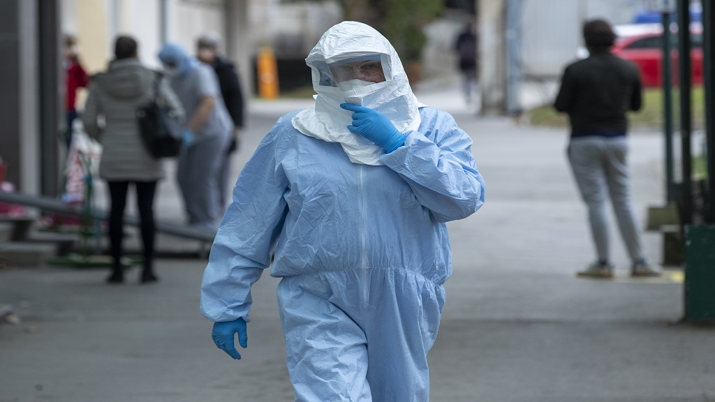 A health worker wears protective suit at the infectious disease clinic in Zagreb, Croatia, where the first coronavirus case in Croatia is hospitalized, Tuesday, Feb. 25, 2020. Croatia confirmed its first case of coronavirus in a man who had been to Milan, the capital of Lombardy, Italy. (AP Photo/Darko Bandic)