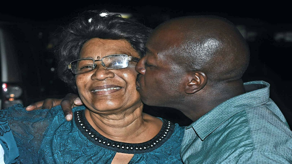 Pearnel Charles Jr celebrates his victory in the South East Clarendon by-election on Monday evening with  a kiss on the cheek of his mom, Gloria, at the counting centre at Vere Technical High School. (Photo: Marlon Reid)