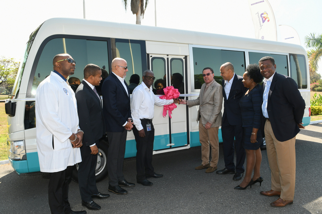 Guardian Life handed over the bus to government and health officials at Jamaica House on Monday.