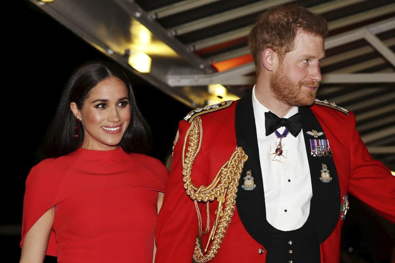 Britain's Prince Harry and Meghan, Duchess of Sussex arrive at the Royal Albert Hall in London, Saturday March 7, 2020, to attend the Mountbatten Festival of Music. (Simon Dawson/Pool via AP)