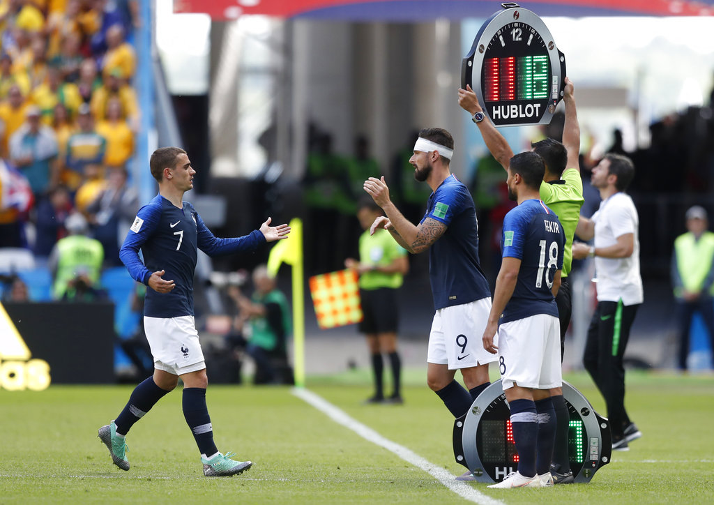 France's Antoine Griezmann, left is substituted and replaced by France's Olivier Giroud during the group C match between France and Australia at the 2018 soccer World Cup in the Kazan Arena in Kazan, Russia, Saturday, June 16, 2018. (AP Photo/Pavel Golovkin)