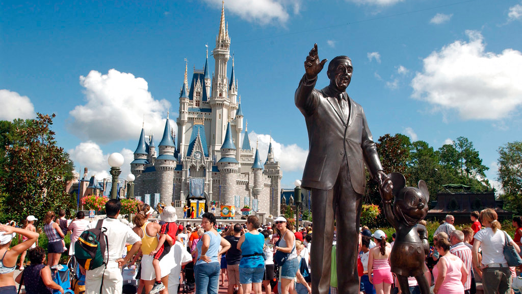 In this Sept. 2, 2004, file photo, tourists crowd around Cinderella's Castle to watch a performance at Walt Disney World's Magic Kingdom in Lake Buena Vista, Fla. (AP Photo/Phelan M. Ebenhack, File)
