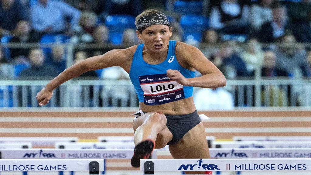 In this Feb. 3, 2018, file photo, Lolo Jones, of the United States, competes in the Howard Schmertz women's 60m hurdles at the Millrose Games track and field meet in New York. After competing in two Summer Olympics as a hurdler and one Winter Games as a bobsledder, Jones, 37, came into the year hoping for one more shot on the track. (AP Photo/Craig Ruttle, File).