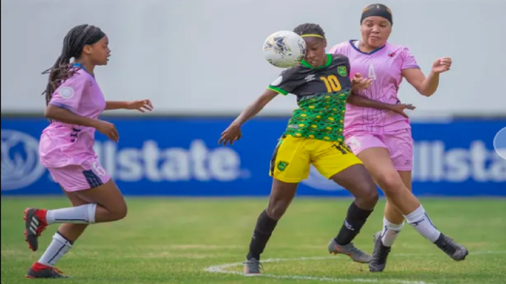 Jamaica's captain Jody Brown (centre) in control against two Bermuda's defenders during their Round of 16 fixture of the 2020 Concacaf Under-20 Women's Championship at the Estadio Panamericano in San Cristobal on Saturday, February 29, 2020. Brown scored four goals to lead Jamaica to a 9-1 victory. (PHOTO: Concacaf).