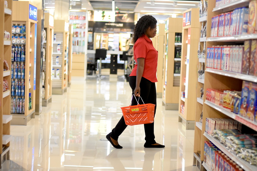 A shopper walks through the isles of Fontana's flagship store in Waterloo Square, Kingston. (Photo: Marlon Reid)