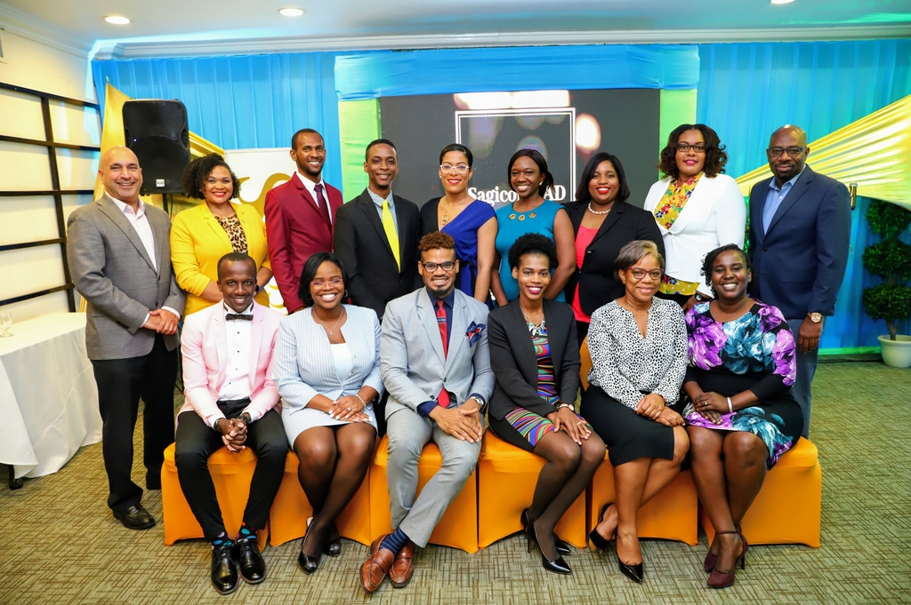 The graduating cohort of the SagicorLEAD leadership development initiative is flanked by Christopher Zacca (1st left, standing), president and CEO, Sagicor Group Jamaica, and Karl Williams (1st right, standing), Senior Vice President, Human Resources and Corporate Services, following the SagicorLEAD graduation and induction ceremony at the Courtleigh Hotel recently.