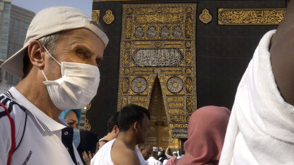 A relatively few number of Muslims pray around the Kaaba, the cubic building at the Grand Mosque, in the Muslim holy city of Mecca, Saudi Arabia, Thursday, March 5, 2020. Saudi Arabia's Deputy Health Minister Abdel-Fattah Mashat was quoted on the state-linked news site Al-Yaum saying that groups of visitors to Mecca from inside the country would now also be barred from performing the pilgrimage, known as the umrah. (AP Photo/Amr Nabil)