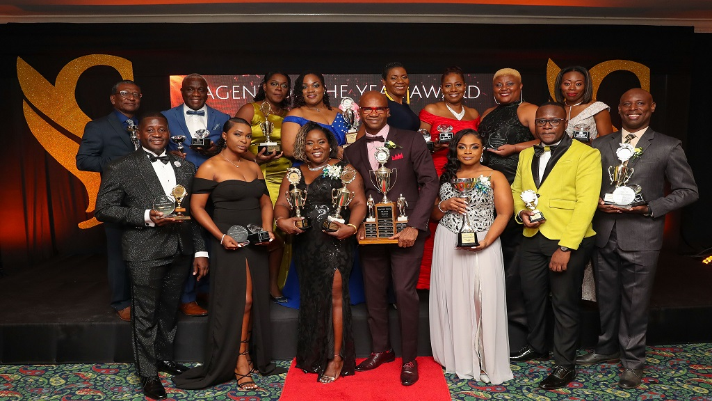 Awardees from the Sagicor Life Jamaica Spanish Town branch displayed their trophies following an awards ceremony for the branch at Knutsford Court Hotel in Kingston on Saturday, March 7.