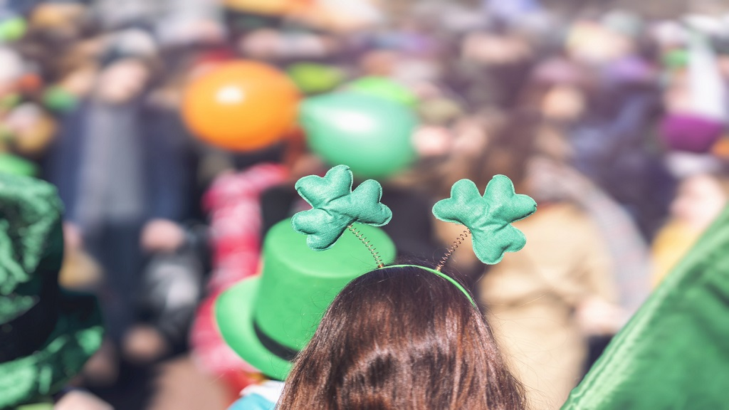 iStock photo of a clover decoration on the head of a girl during a St Patrick's Day parade.