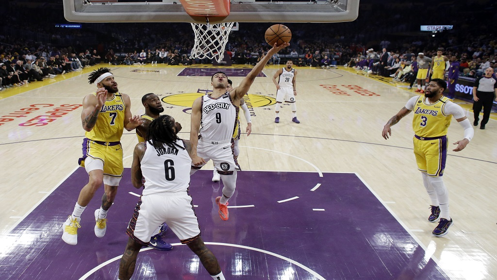 Brooklyn Nets' Timothe Luwawu-Cabarrot (9) drives to the basket against the Los Angeles Lakers during the first half of an NBA basketball game Tuesday, March 10, 2020, in Los Angeles. (AP Photo/Marcio Jose Sanchez).