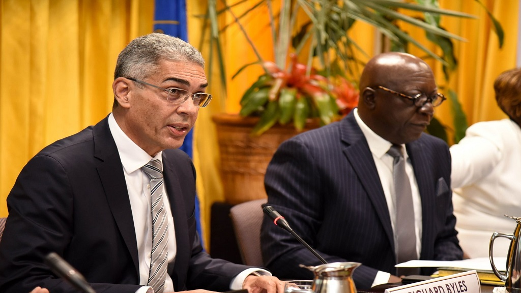 File photo of Bank of Jamaica Governor Richard Byles (left). Also pictured is deputy governor John Robinson.
