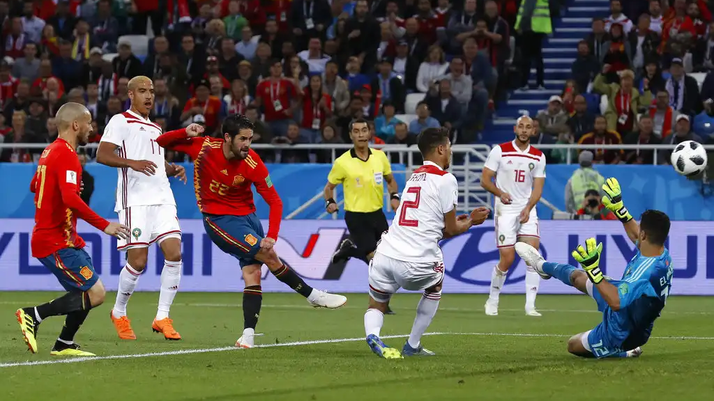 Spain's Isco, 3rd left, scores his side's opening goal during the group B match between Spain and Morocco at the 2018 World Cup at the Kaliningrad Stadium in Kaliningrad, Russia, Monday, June 25, 2018. (AP Photo/Manu Fernandez)