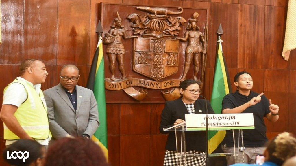 Chief Medical Officer JacquilineBisasor-McKenzie addresses journalists at a press conference Wednesday. Health Minister Dr Christopher Tufton (left) and Permanent Secretary in the Ministry of Health and Wellness, DunstanBryan are also pictured. (Photo: Marlon Reid)