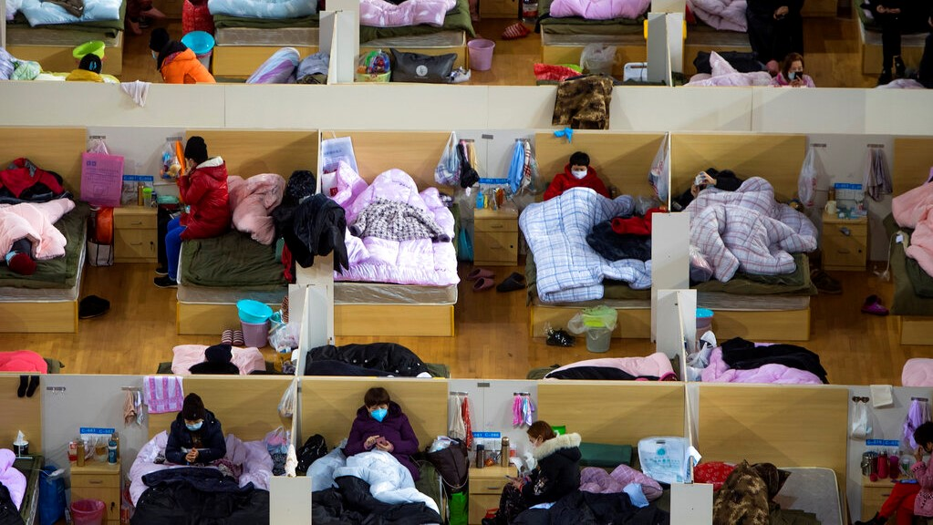 In this Monday, Feb. 17, 2020, photo released by Xinhua News Agency, patients infected with the coronavirus take rest at a temporary hospital converted from Wuhan Sports Center in Wuhan in central China's Hubei Province. (Xiao Yijiu/Xinhua via AP)