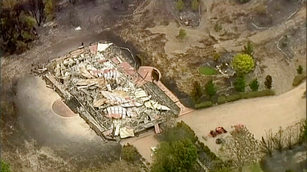 In this image made from video, an aerial scene shows destroyed homes and properties after a wildfire in East Grippsland, Victoria, December 31, 2019. Wildfires burning across Australia's two most-populous states Tuesday trapped residents of a seaside town in apocalyptic conditions, destroyed many properties. (Australian Broadcasting Corporation, Channel 7, Channel 9 via AP)