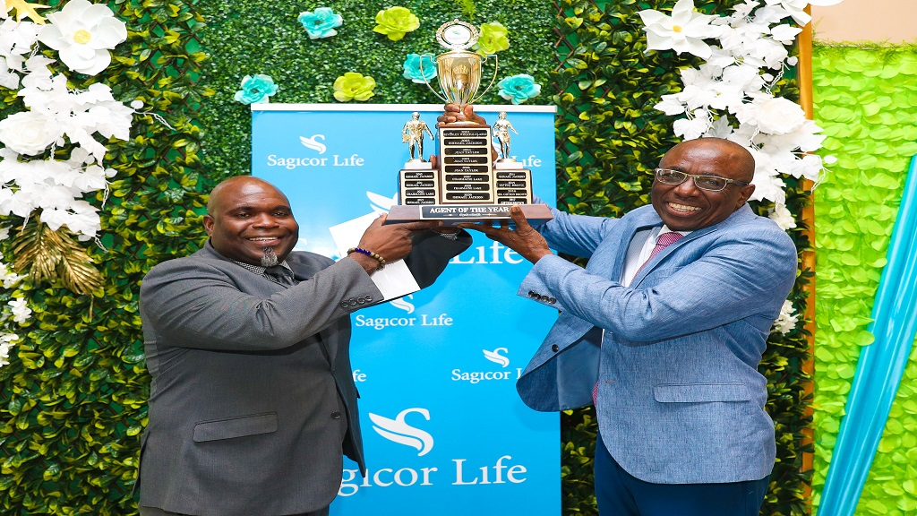 Philbert Perry (left) assistant vice president, Sagicor Life Jamaica, celebrates with financial advisor Gifton Brown, who was awarded Branch Advisor of the Year, at the Sagicor Life Ocho Rios branch awards ceremony at Riu Hotel recently.