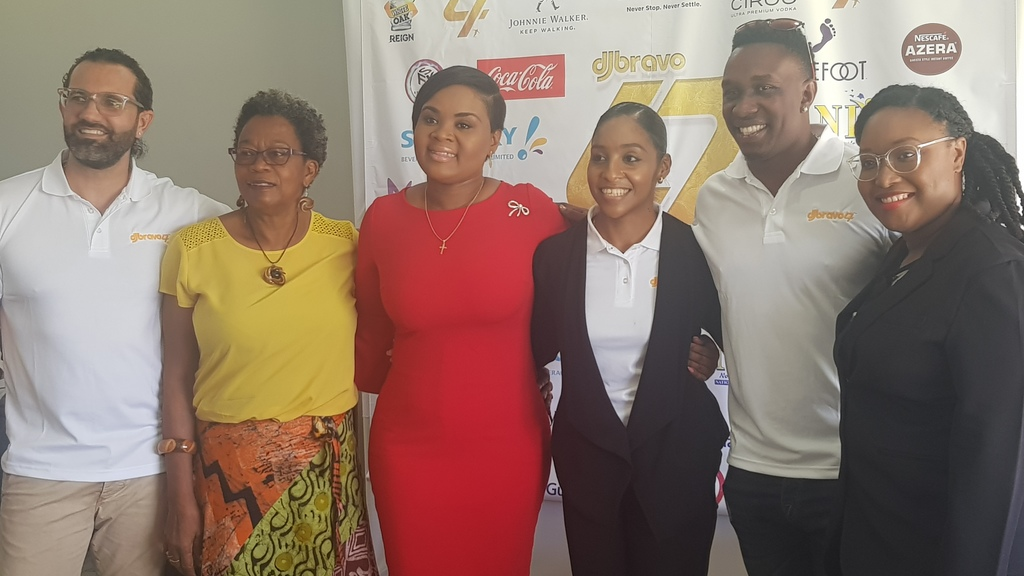 Dwayne Bravo with Sports Minister Shamfa Cudjoe and representatives from the Couva Children's Home.