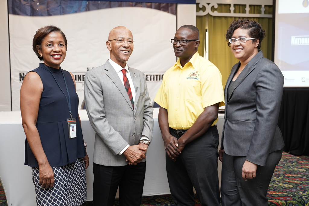 From left to right: Audrey Richards (left), Jamaica Venture Capital Programme Project Coordinator, Development Bank of Jamaica Managing Director Milverton Reynolds,  Markland Murphy (second right), Research Coordinator & Projects Director, at the College of Agriculture, Science and Education (CASE) and  Tracy LaCroix, PSOJ's Senior Manager – Finance and Operation at the National Business Model Competition launch.
