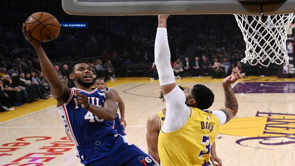 Philadelphia 76ers forward Glenn Robinson III, left, shoots as Los Angeles Lakers forward Anthony Davis defends during the first half of an NBA basketball game Tuesday, March 3, 2020, in Los Angeles. (AP Photo/Mark J. Terrill).