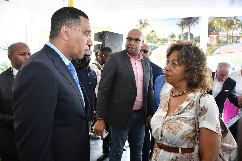 Jampro President Diane Edwards speaks to the Most  Andrew Holness at the groundbreaking of the Sugarcane Bay Development project.