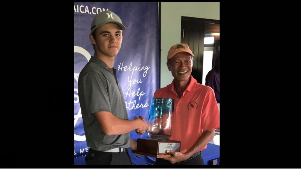 The improving Rocco Lopez (left) collects his trophy from CEO of Scientific & Medical Supplies (SMS), Howard Law following his second place finish in the SMS Golf Classic at Caymanas Golf Club recently.