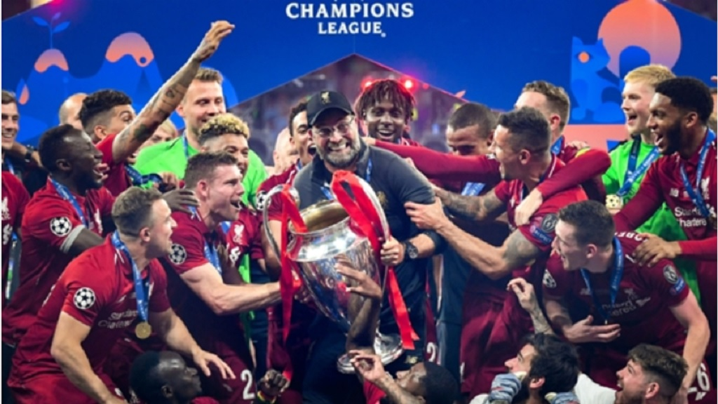 Liverpool FC players hoist the Champions League trophy after defeating Tottenham in the finals of last year's staging.