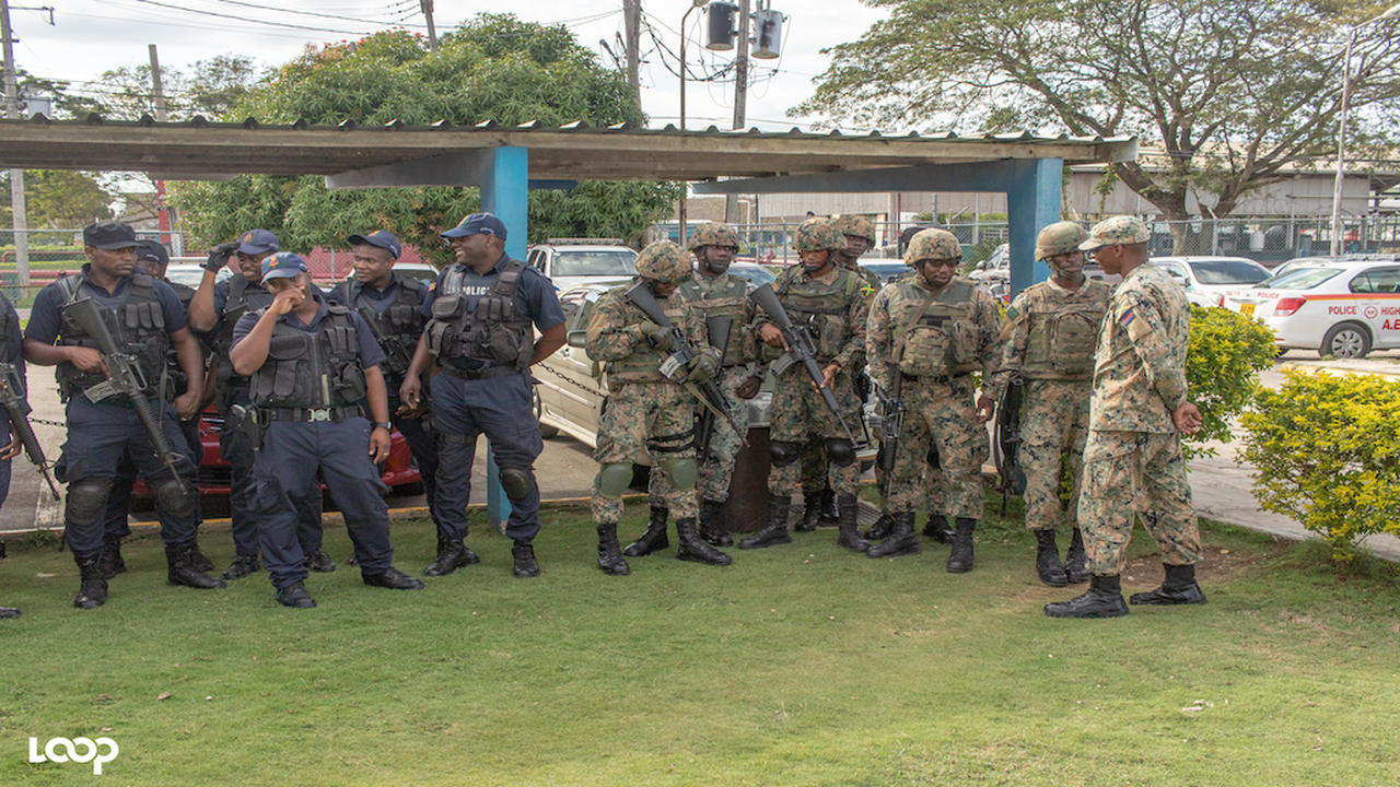 File photo of police officers and JDF soldiers ahead of an operation.