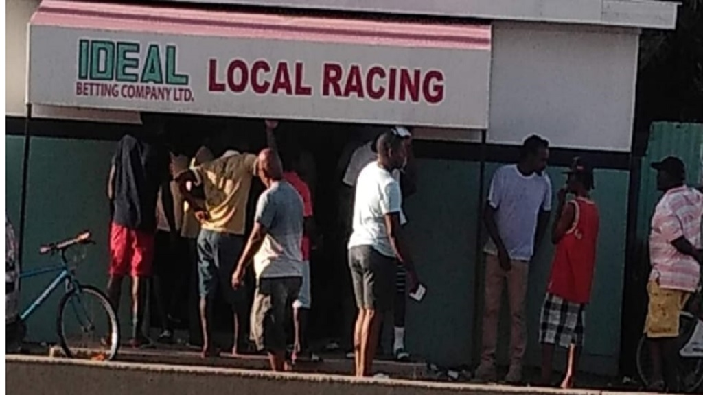 Patrons gathered at a betting shop in Portmore, St Catherine on Saturday, March 21,  defeating the Government's appeal for 'social distancing' in its efforts to curb the spread of the novel coronavirus (Covid-19).