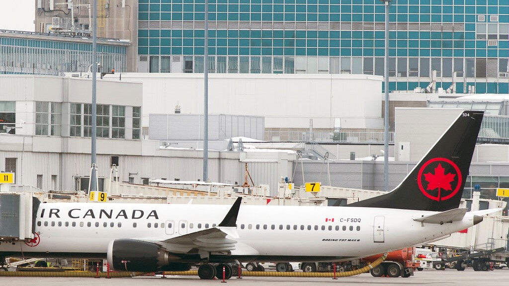 An Air Canada Boeing 737 Max 8 aircraft is parked next to a gate at Trudeau Airport in Montreal, Wednesday, March 13, 2019. (Graham Hughes/The Canadian Press via AP)
