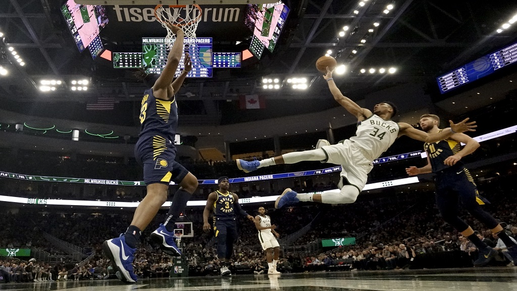 Milwaukee Bucks' Giannis Antetokounmpo shoots after being fouled during the second half of an NBA basketball game against the Indiana Pacers Wednesday, March 4, 2020, in Milwaukee. The Bucks won 119-100. (AP Photo/Morry Gash).